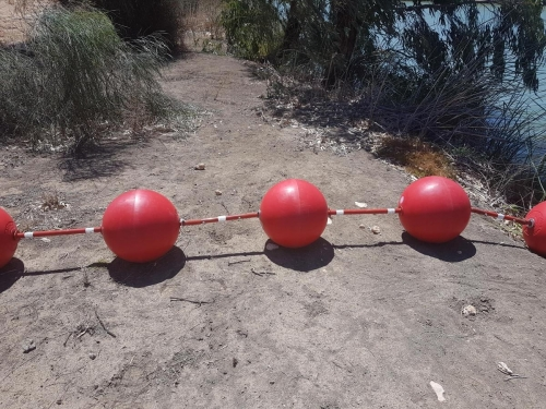 Red Round Buoys, Floating Barrier on Lake Victoria in SA -3